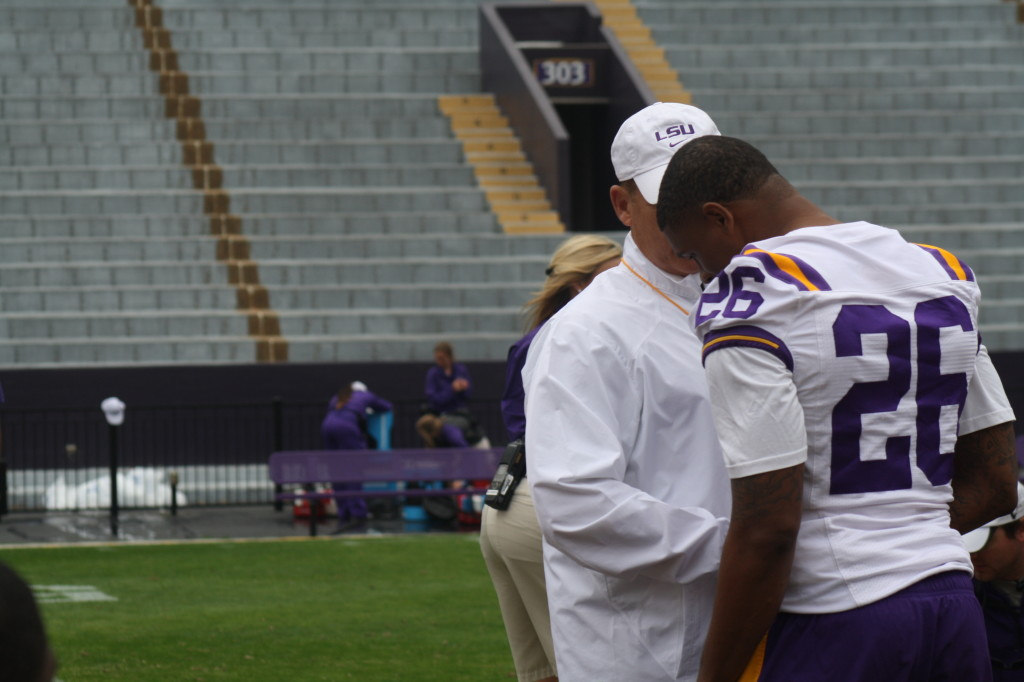 Coach Miles gives Jalen Mills a award.