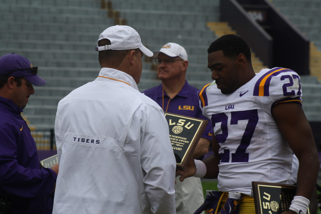 Coach Miles gives a award to Kenny Hillard
