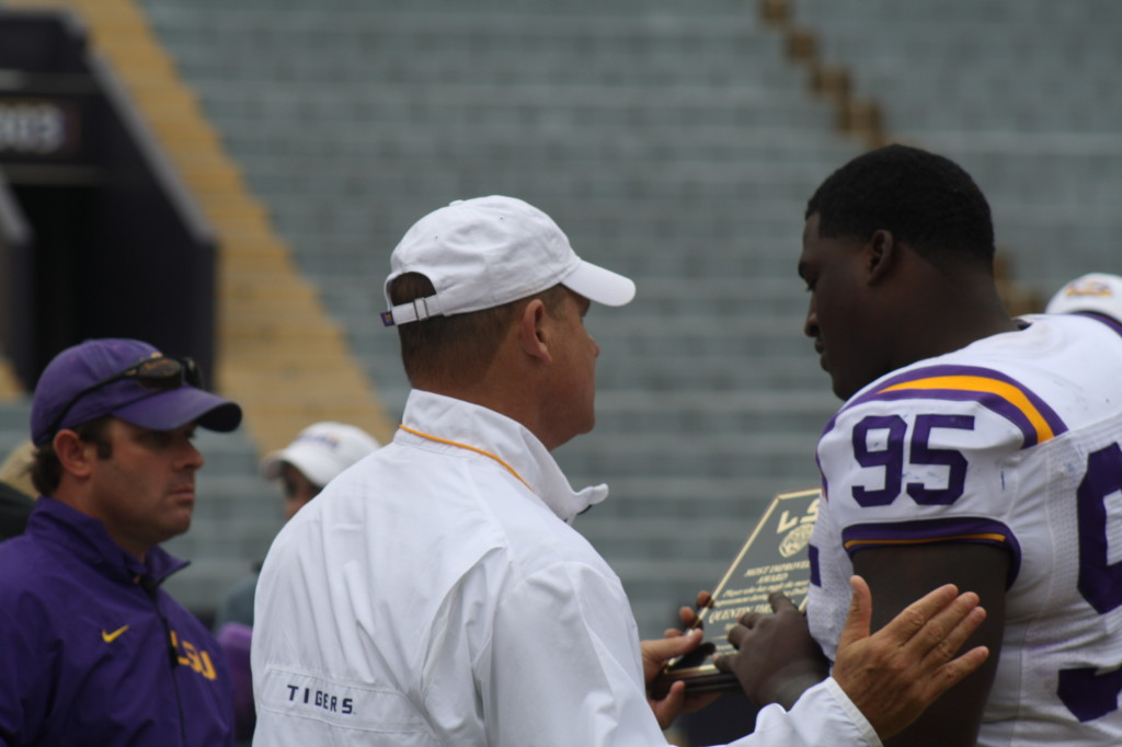 Quentin Thomas receives a award from Coach Miles