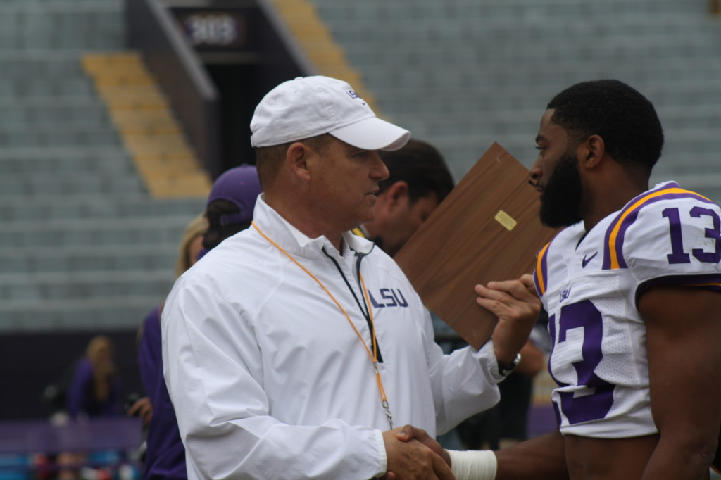Dwayne Thomas gets a award from Coach Miles
