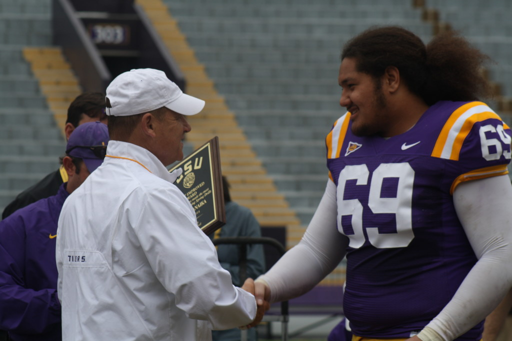 Cocoa Fanaika receives a award from Coach Miles