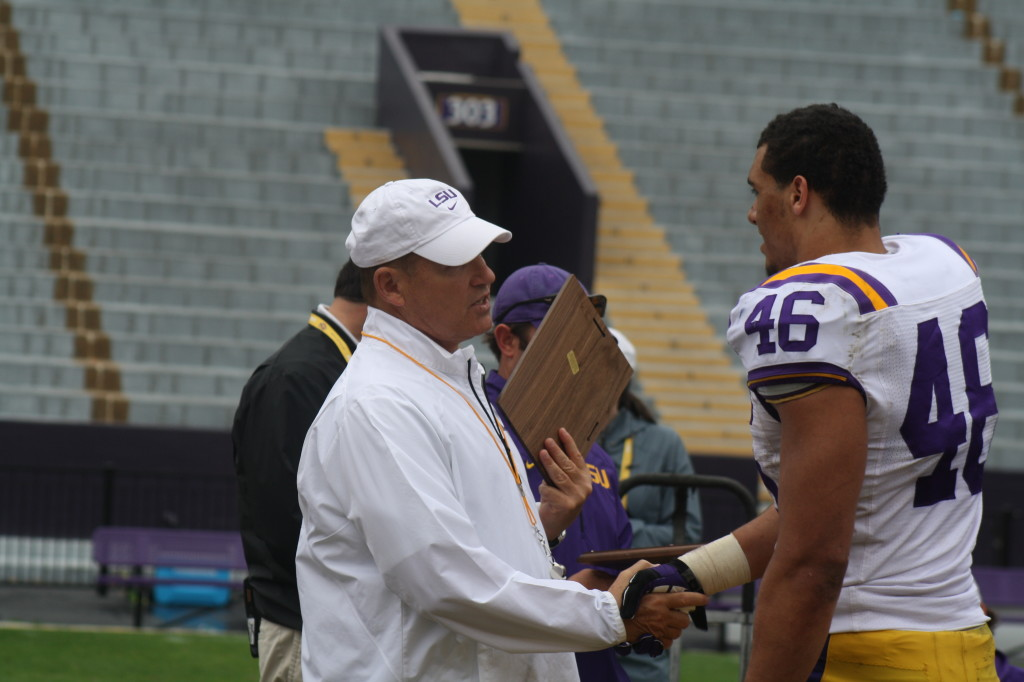 Tashawn Bower receives a award from Coach Miles