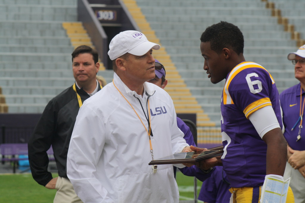 Coach Miles gives Brandon Harris a award.