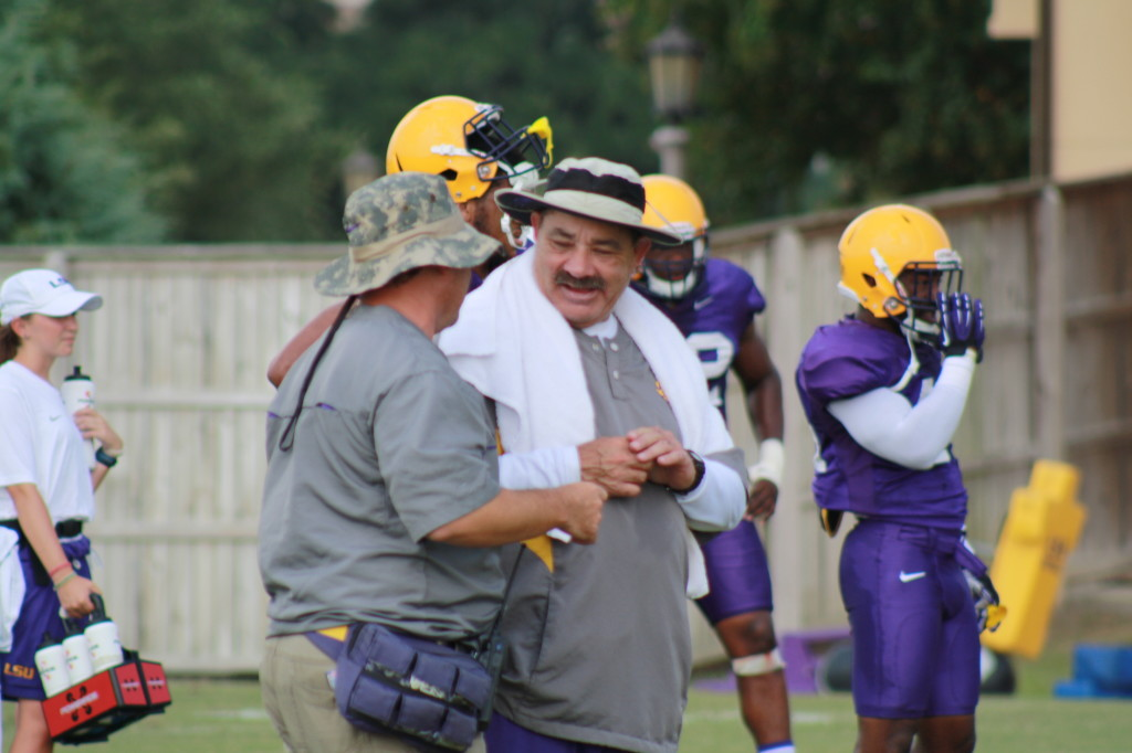 Defense Coach Chavis having a chat during the summer practice