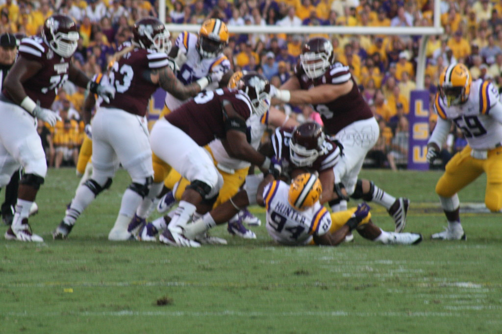 Down goes MSU qb Prescott as DE Hunter records a sack.