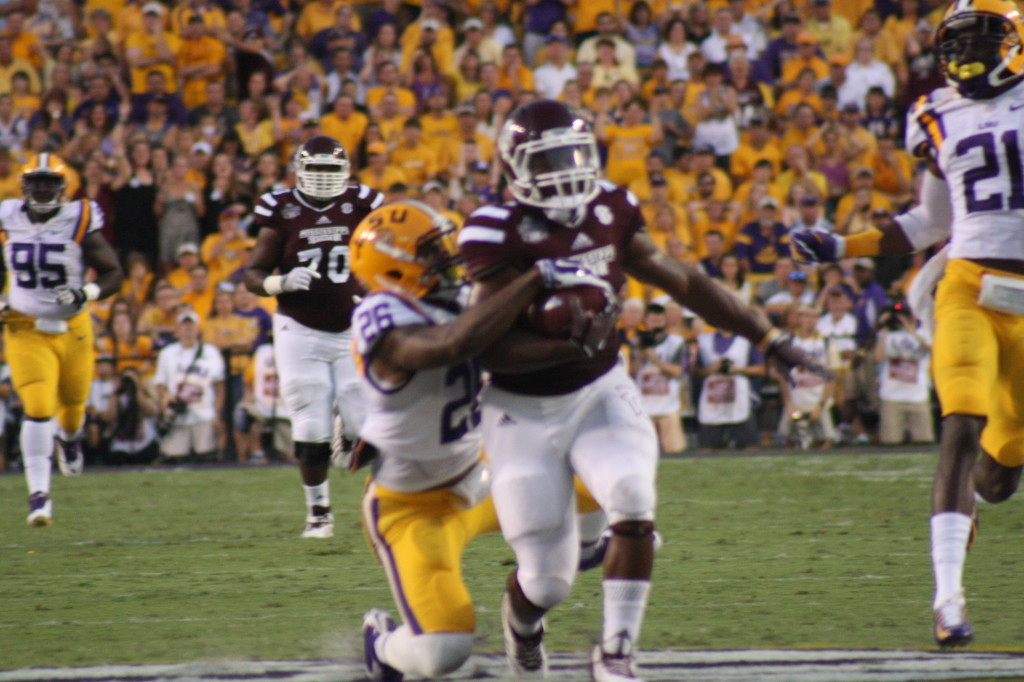 LSU Rolnald Martin catches up with a MSU running back.