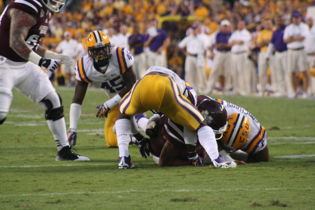 You can see no.63 Dillion Day approaching LSU's Devon Godchaux.