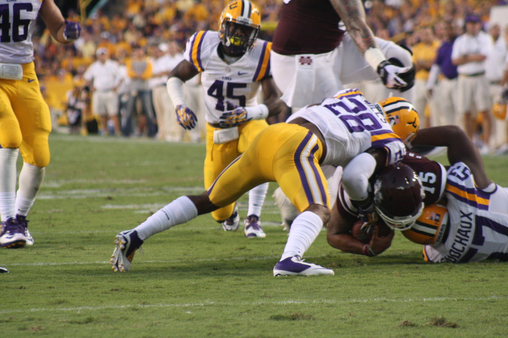 MSU Dillon Gay is in the air as he is about to step on LSU's Devon Godchaux, what a dirty play.