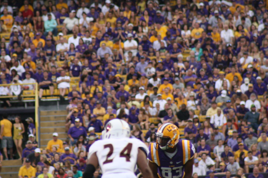 LSU Travin lining up for the next play, Tiger fans looking on.