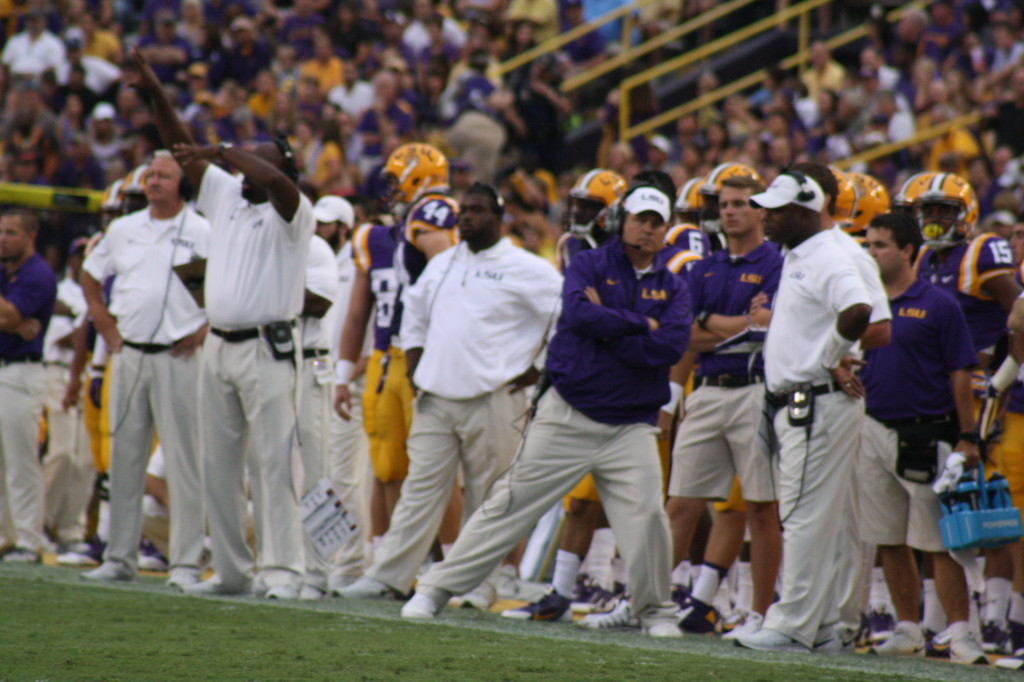 Coach Miles doing a Blues Brother move on the sideline.