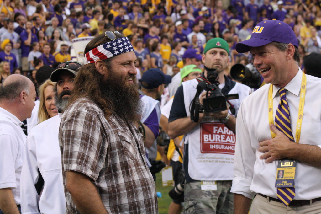 Willie Robertson, Duck Dynasty having some laughs at Tiger Stadium.