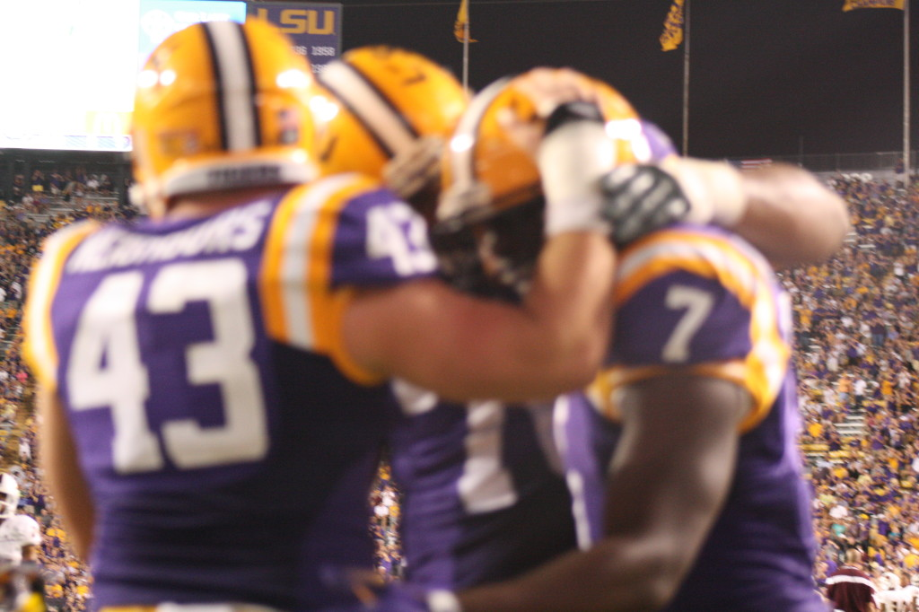 LSU Connors and Collins  congratulate Fournette on his TD.