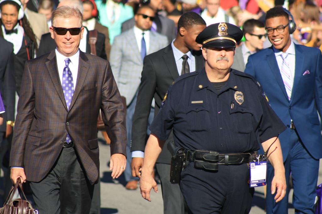 LSU Offense Cordinator Cam Cameron walking down to Tiger Stadium