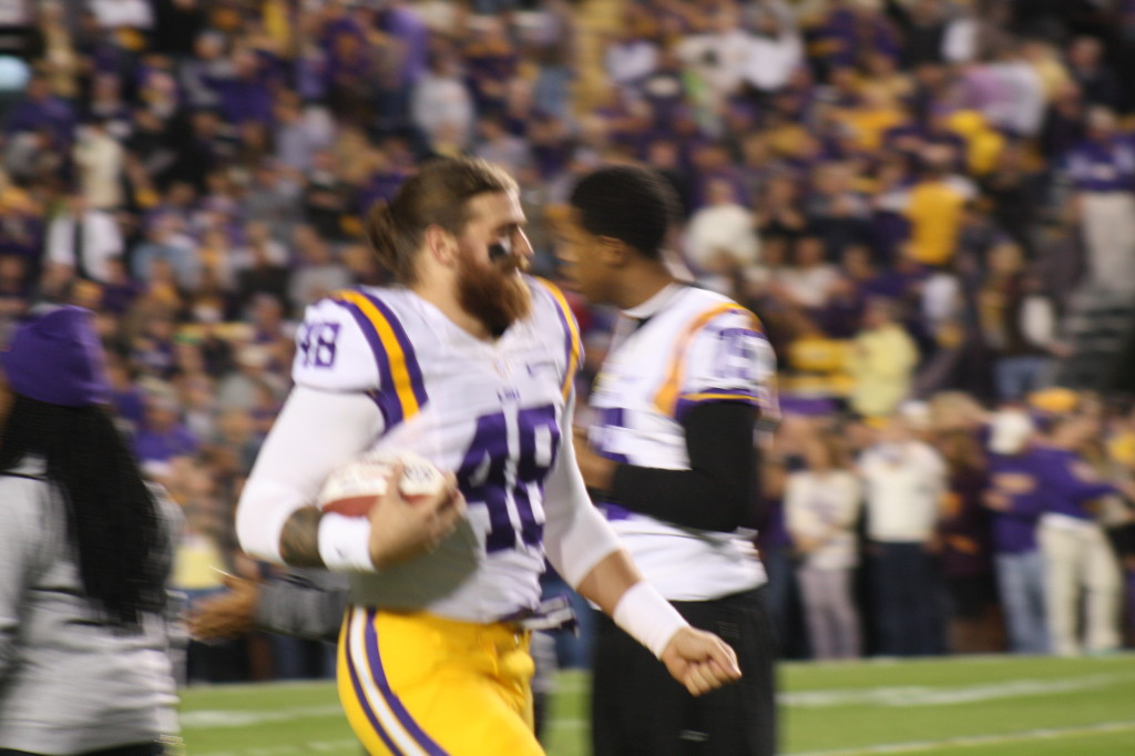 LSU Jake Franklin runs out for Senior Day to meet his family.