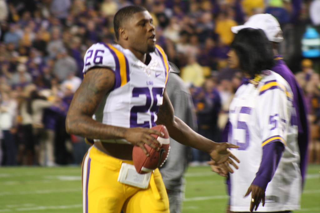 no.26 Ronald Martin running to meet his family during Senior Day as a LSU Tiger.
