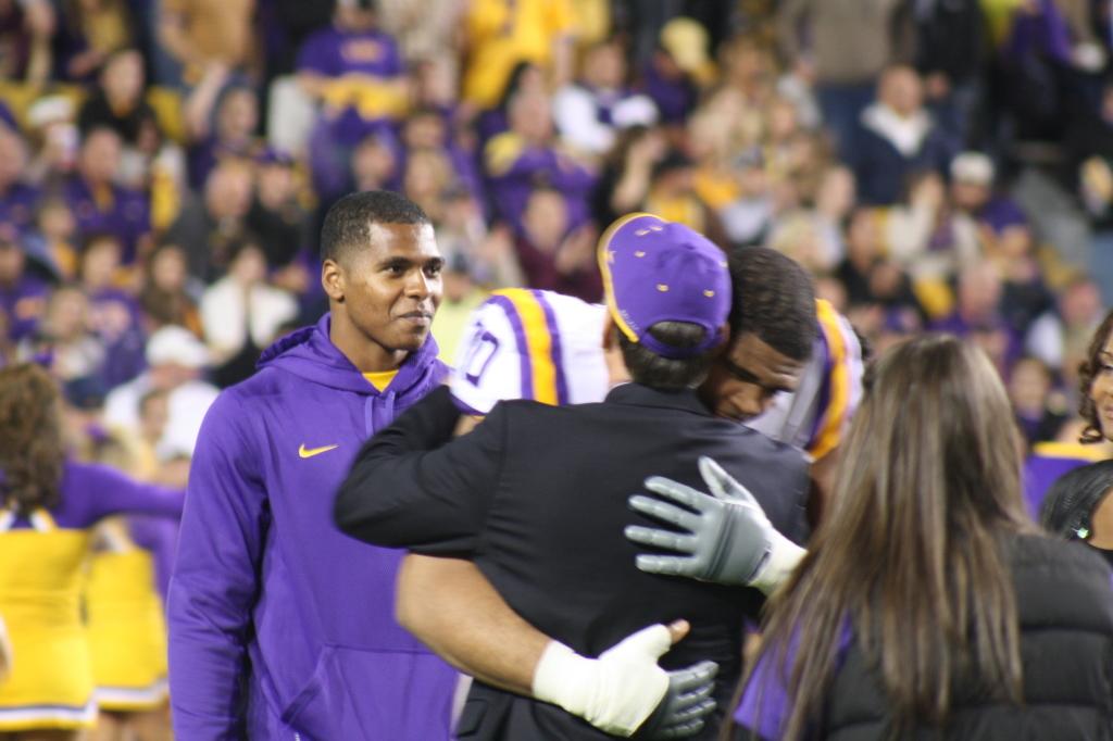 LSU La'el Collins gives LSU Chancellor King Alexander a hug....  during LSU Senior Day.