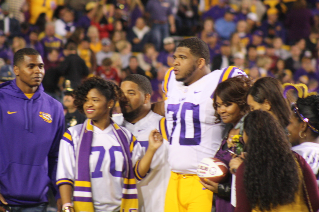 LSU La'el Collins taking a picture with his family
