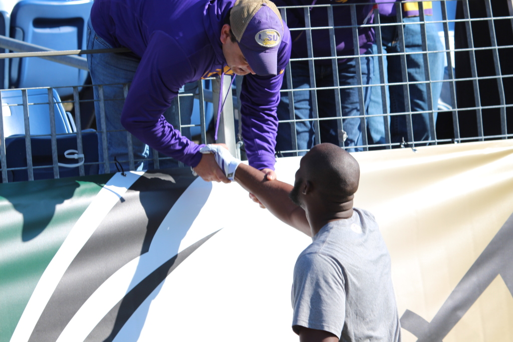 LSU Fournette says hello to a LSU Fan at the Music City Bowl.