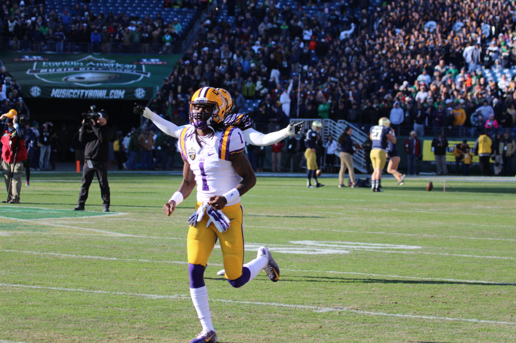 LSU wr Quantavius Leslie runs out on the field with the Tigers one last time.