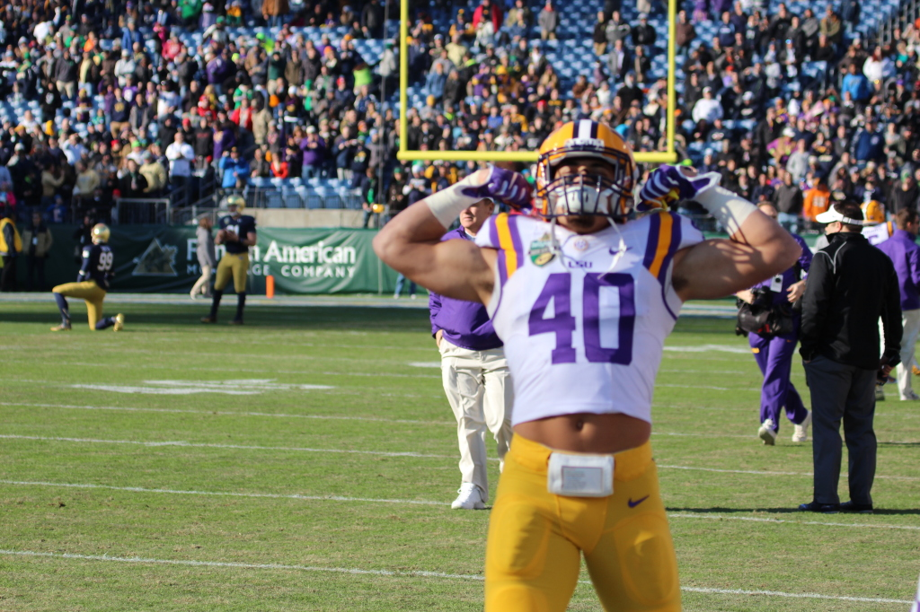 LSU Duke Riley flexes his muscles before the Notre Dame Game....
