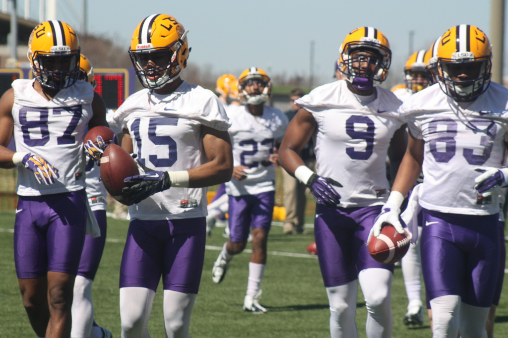 Here comes the LSU Receivers, left to right Clark, #82, Dupree #15, Diarse #9, and Dural #83.