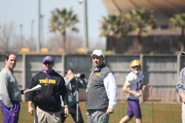 LSU Coach Miles looks on as the QB's are going thru some throwing drills.