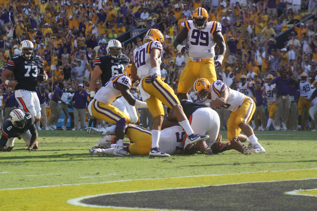 LSU Gilmore no.99 jumps for joy as LSU recovers the fumble inside the 10 yard line.