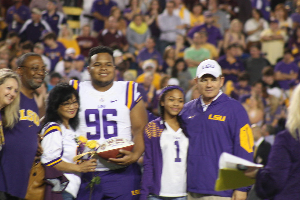 Coach Miles taking a pic with Micky Johnson and his family.
