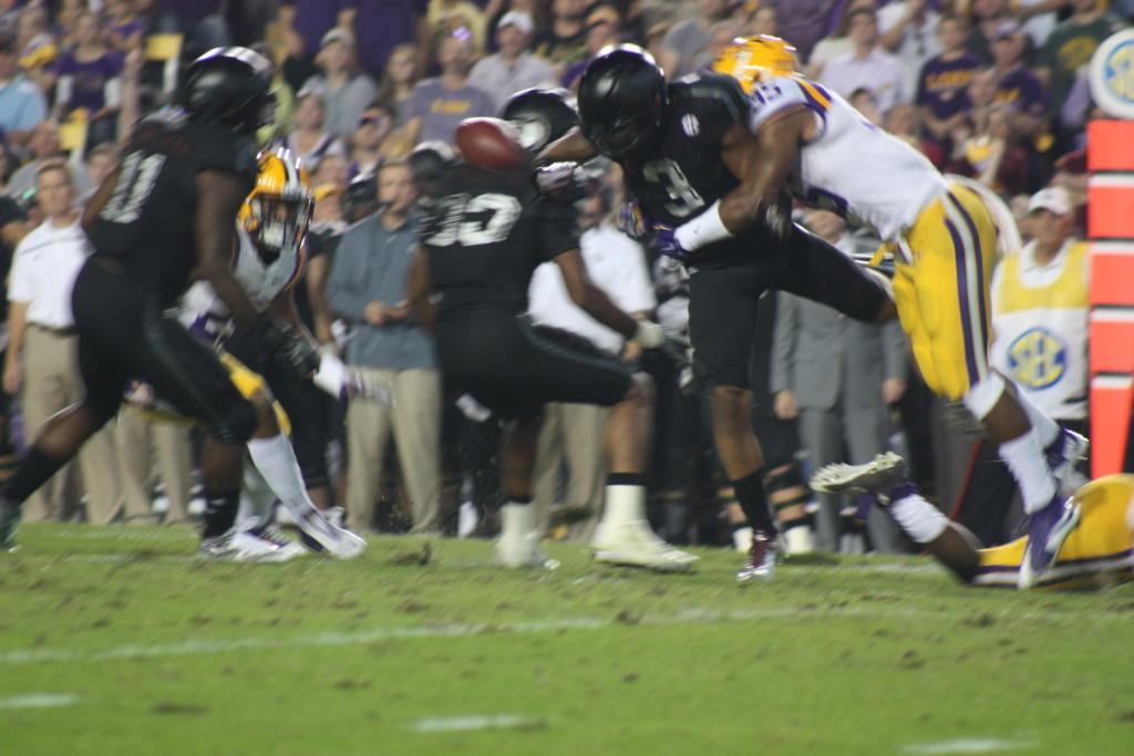 LSU Deion Jones hits AM kick returner as he jars the ball loose.