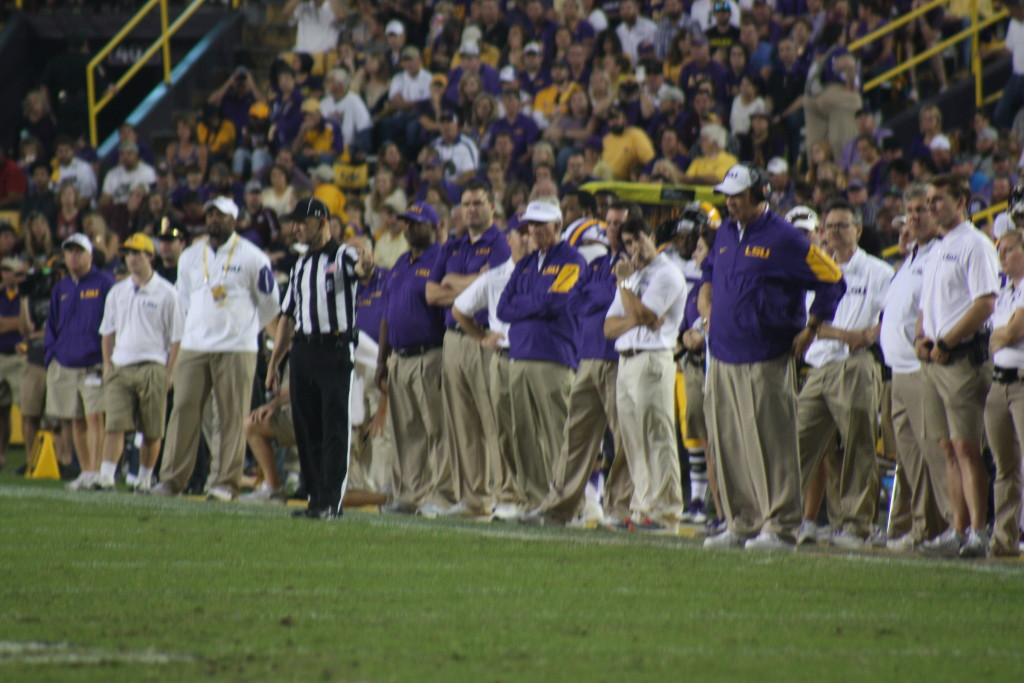 LSU Coach Miles calling the plays.