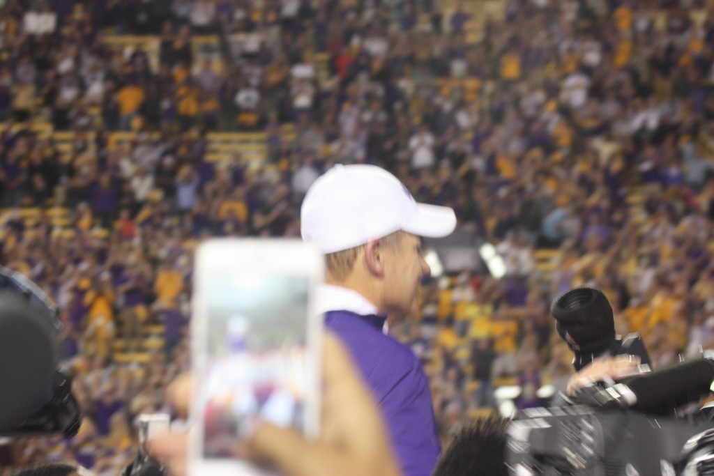 Coach Miles is getting carried off the field as they beat Texas AM 19-7.
