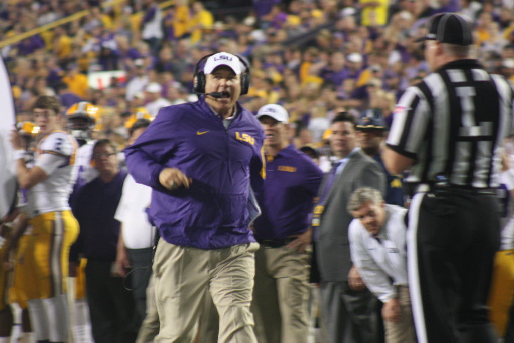There goes Coach Miles to talk to the refs.