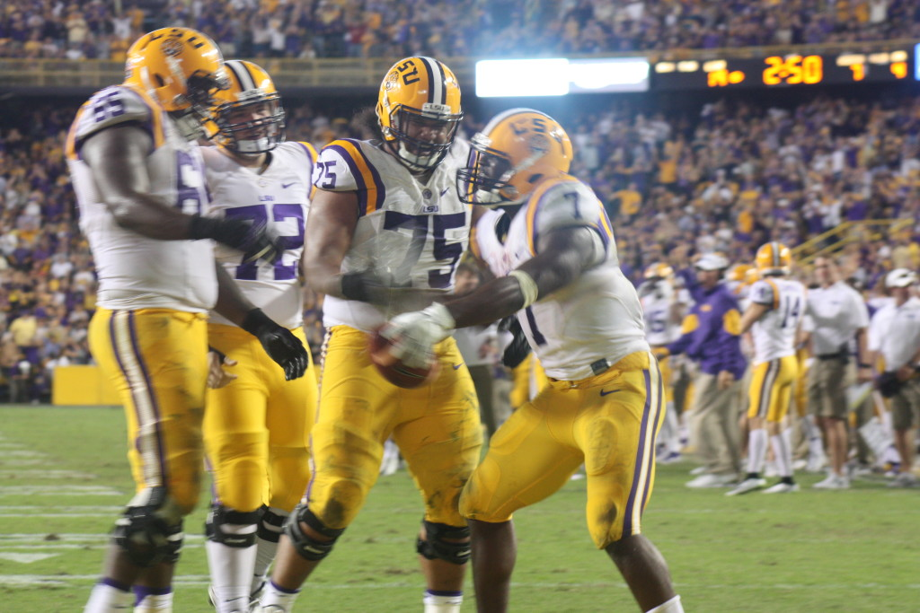 Fournette starts the celebration with the lineman.