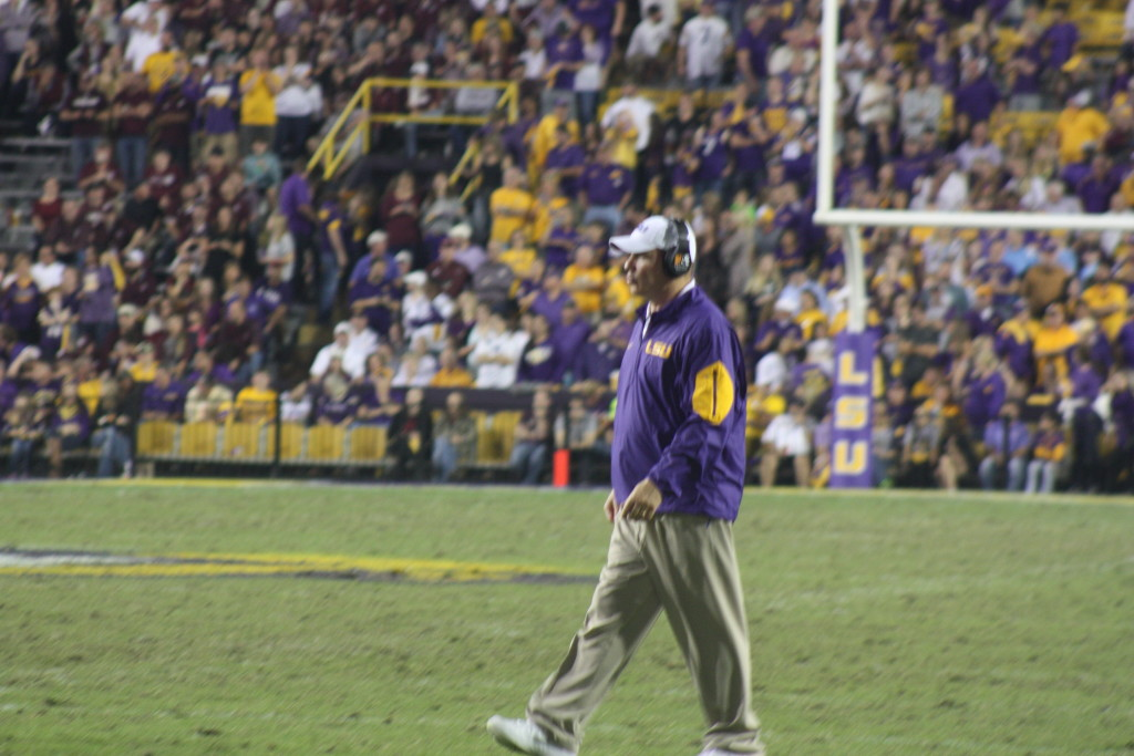 Coach Miles walking out to see if Brandon Harris is okay.
